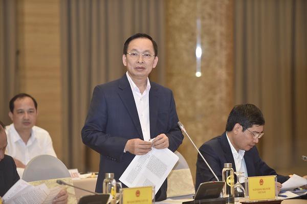 Phó Thống đốc NHNN Đào Minh Tú trả lời các câu hỏi của phóng viên. Ảnh: VGP